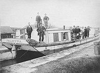 Men on a canal boat on the Erie Canal