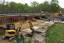 Nine Mile Creek Aqueduct restoration - Bottom timber being swung into place