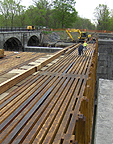 Nine Mile Creek Aqueduct restoration - Bottom timber in its temporary location