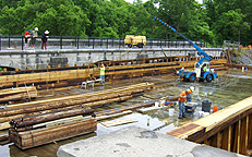 Nine Mile Creek Aqueduct restoration - Side beam being swung into place