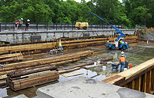 Nine Mile Creek Aqueduct restoration - Side beam being fitted into place